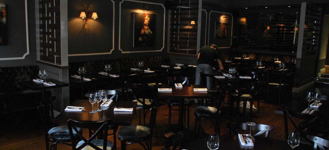 Dark and light As the chairs and tables are dark, but at the same time you have alot of light coming through the windows.